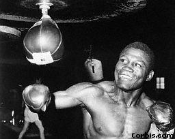 Dick Tiger punching speedbag december 7, 1961