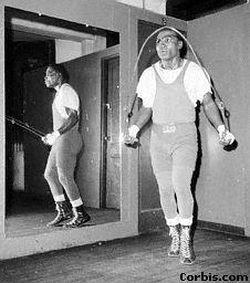 Dick Tiger in sweats skips rope New York City November 12, 1963