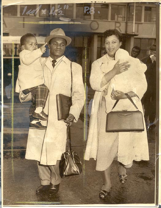 Featherweight boxing champion Hogan Kid Bassey with his wife and two children travelling to the United States, 1958