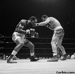 Jose Torres (right) punches Dick Tiger New York City May 16, 1967